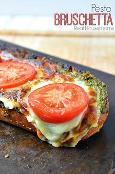 Agnese Italian Recipes: Pesto Bruschetta : Original Italian Recipe  Everyone that tries Pesto Bruschetta falls in love with it.  There is no way you can do better than warm bread, pesto sauce, cheese and roasted tomatoes!  This is always a crowd pleaser and the leftovers (if there are any) are just as good the next day for lunch