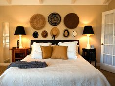 Design Ideas: Wall Decor With Hat And Basket. large wall decor. hat wall decor. cream bedroom. black lamp shade. white bedding.