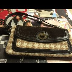 Wool and leather coach wristle Super clean never wear it super nice for winter.  Is new with out the tags. Coach Bags Clutches & Wristlets