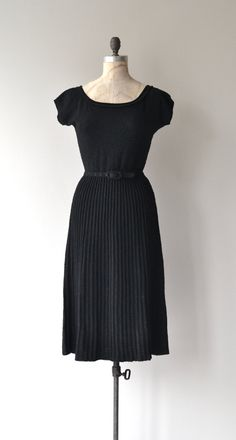 Vintage 1950s black boucle wool knit (quite soft) dress with wide neckline, short sleeves and matching belt. --- M E A S U R E M E N T S ---  fits