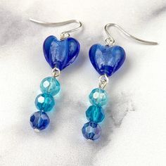 Croí Earrings These blue glass heart Croí earrings make the perfect gift for your loved one this Valentine's Day. Heart Earrings, Drop Earrings, Earrings Handmade, Handmade Jewelry, Beaded Jewelry, Jewellery, Unique Gifts For Her, Glass Beads, Gift Ideas