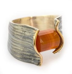 "Ring | Elisenda de Haro. ""Manglar collection"". Stone, rust/oxidization and gold"