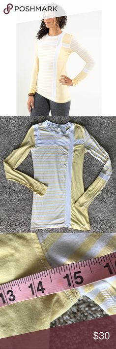 "Lululemon Promenade Long Sleeve Tee Size 4 We love to cover up with lightweight, cozy layers when we're cooling down after class. Made of soft, breathable Vitasea fabric, this top helps us hold on to our post-practice warm fuzzies and let go of our extra heat. Color is twin stripe heather sizzle/white/sizzle.  Laying flat, bust measures 15"" and length is 27.5"". Tiny hole on sleeve as seen in last photo. EUC from a smoke free home!  ⭐️no trades⭐️  ⭐️I'm open to offers and I ALWAYS send a…"