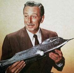 "Walt Disney with a Model of the Nautilus from His Film Interpretation of the Immortal Jules Verne Novel, Leagues under the Sea"" Walt Disney Co, Old Disney, Disney Love, Disney Parks, Nautilus Submarine, Walter Elias Disney, Leagues Under The Sea, Vintage Disneyland, Great Films"
