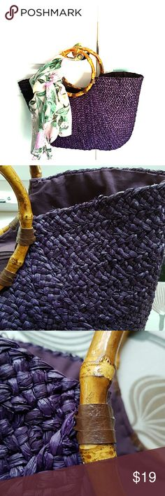 Straw bag in purple Lovely straw bag in excellent condition.  I believe I only used it once on a cruise.  It is quite roomy.  Has inside pockets and zips up on the top. Purchased at Nordstrom. Straw Studios  Bags Totes
