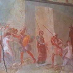 Art on the wall inside a home in Pompeii, Italy can still be seen.