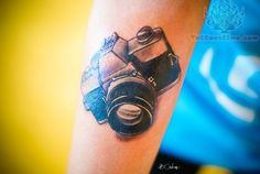 photo camera tattoo awesome, but still searching for a television tattoo for me to do.