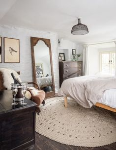 Master bedroom with beautiful Nordic House natural wool rug