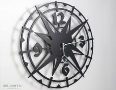 """Metal Wall clock COLOMBUS -  40 cm / 16"""" - Laser cutting design - © Tolonensis Creation -  This clock is an original creation designed by french creator Jacques Lahitte. Shipping within EU countries, USA, Canada, Japan, Australia... Contact us for other destinations."""