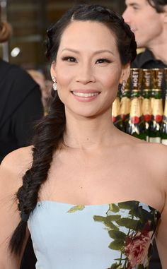 Lucy Liu adds dimension with soft, pretty eyeshadow that gradually fades from dark at the lashline to light on the upper lid.