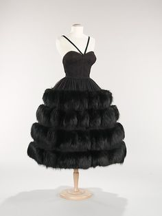 Dress, Evening  Norman Norell  (American, 1900–1972)    Department Store:      Nan Duskin  Date:      ca. 1958  Culture:      American  Medium:      synthetic, fur  Dimensions:      Length at CB: 32 in. (81.3 cm)