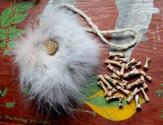 Wolf bone runes and wolf fur pouch set by Lupa. At http://www.ebay.com/itm/-/141854051973?