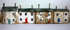 Kirsty Elson, Driftwood Cottages - Freestanding cottages made with driftwood, slate and rusty nails - and decorated with a touch of paint! Joined by a piece of wood along the back http://www.kirstyelsondesigns.co.uk/a1-gallery2.asp?roomID=2850