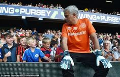 Mourinho chats with some young fans as he got into the spirit of the celebrity game