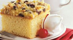 Serve your family with this easy lane cake that's topped with pecans and coconut - a superb tropical dessert.