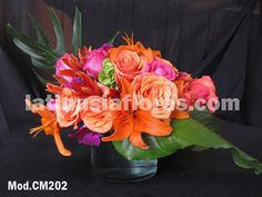 #orange roses, #fyusha roses and #orange lilies #wedding #centerpiece