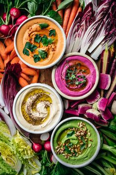 Hummus 4 Ways We're sharing four of our favorite hummus variations, including an easy, classic hummus recipe! The three additional flavors include: Pesto, Roasted Red Pepper + Harissa and Pickled Beet. Classic Hummus Recipe, Pesto Hummus, Vegan Hummus, Vegan Vegetarian, Vegetarian Recipes, Comida Fusion, Veggie Recipes, Healthy Recipes, Gastronomia