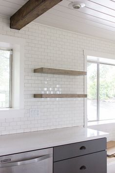 White 'brick' tile, 'floating' rustic shelves (links to building and instalation instructions), exposed beams, and bead board ceiling.