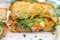 Guacamole Grilled Cheese Main INGREDIENTS  2 slices of bread ⅓ cup Best Damn Guacamole Ever! 5 fresh sprigs of cilantro 2 slices of tomato ⅓ cup Cheddar, shredded ½ tablespoon butter