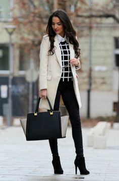 Skinny pants tucked into ankle boots are work chic.