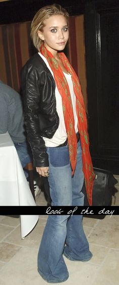 Wide Leg Denim (great pocket detail), simple leather jacket, casual white shirt, colored scarf. Nice! (Ashley Olsen)