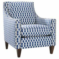 """Bring eye-catching style to your living room or master suite with this bold nailhead-trimmed arm chair, showcasing chic geometric upholstery in cobalt blue and oxford white.   Product: ChairConstruction Material: Wood and fabricColor: Cobalt blue and oxford whiteFeatures:  Made in the USAArms are outlined in a double row of pewter nailhead trimSki jump track armLoose pillow back Dimensions: 36"""" H x 35.5"""" W x 29.5"""" D Note: Assembly required"""