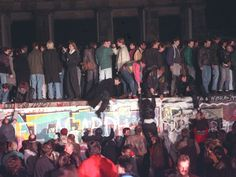West Berlin citizens continue their vigil atop the Berlin Wall in front of the Brandenburg Gate, November 10, 1989.