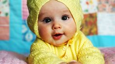 Baby with fashionable sweter.