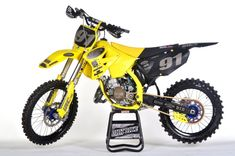 Our 2001 Suzuki project makes its debut on this week's Two-Stroke Tuesday brought to you by Boyesen. Products from Barnett Clutches, and CCR Suzuki Dirt Bikes, Suzuki Motocross, Motocross Bikes, Dirt Bike Couple, Motocross Maschinen, Dirt Bike Magazine, Off Road Bikes, Dirtbikes, Performance Parts