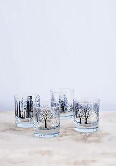 A beautiful boxed set of four heavy bottomed glasses with bold printed images of trees by Snowden Flood.