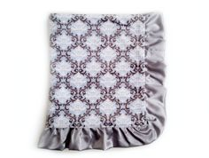 Snow Waltz luxury baby blankets featured here in a beautiful blue, white and silver damask. Elegantly handcrafted from premium quality fabrics.