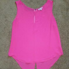 Key Hole Tank Hot pink chiffon tank with key hole neck detail and back zipper. 100% Polyester Naked Zebra Tops Tank Tops