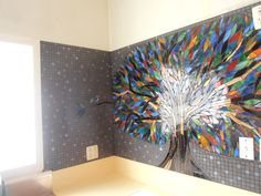 Sideview of Mosaic/Glass Tree Splashback with blue robin on end branch