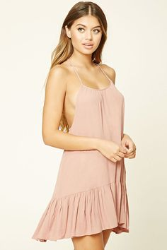 A semi-sheer crinkled woven swim cover-up dress featuring cami straps, a T-back, and a shirred skirt hemline.