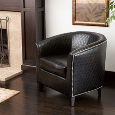 Add a touch of decorative detail with this black bonded-leather club chair. This chair boasts design details such as decorative stud detail, a quilted pattern, and black-stained legs. This attractive chair will add sophistication to any home.