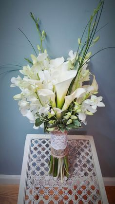 Calla Lilies and Orchids. Designed by Scarlett's Flowers