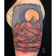 Abstract mountain tattoo.