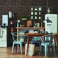 I like the brick wall and industrial feel. The pastel colours keep it homely.