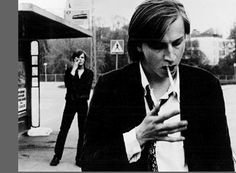 a young finnish film director lighting a cig
