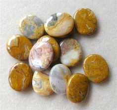 Crazy Lace Agate, Oval Pendant, Gemstone Pendant, Agate Gemstones, Craft Supplies, Jewelry Making Beads, Necklace Design, Bead Supplies   Featured are crazy lace agate oval gemstone pendants. These are beautiful pendants with a great polish, yellows, creams and tans in color with interesting patterns and are center drilled top to bottom. These semi precious pendants measure 25 x 30mm. Theyd look great with golden yellow beads, agate beads, pearls, Swarovski crystals and gold or antique…
