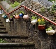 Planters made from old tea kettles