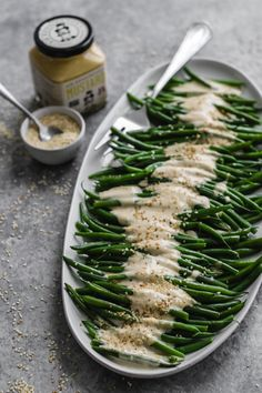 Dijon Tahini Green Beans Get your greens in with this saucy side that's oil free with a creamy dijon tahini dressing. Perfect to compliment your holiday spread. Vegan Side Dishes, Vegetable Side Dishes, Side Dish Recipes, Vegetable Recipes, Vegetarian Recipes, Healthy Recipes, Kale Recipes, Avocado Recipes, Veggie Food