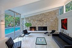 Love the fireplace, glass and stone Modern Charlotte - Mid century modern fireplace Mid Century House, Mid Century Style, Mid Century Modern Design, Mid-century Interior, Modern Interior Design, Interior And Exterior, Stone Interior, Modern Exterior, Palm Springs