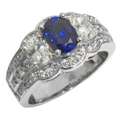 #sparkle | Sapphire and diamond ring with one 7x5mm oval sapphire, 2 oval diamonds 0.60ct tdw and 8 round diamonds 0.18ct tdw set in 14k white gold | www.hannoush.com