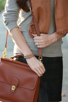 Neutrals: grey sweater, leather skirt, camel scarf and Coach Willis bag