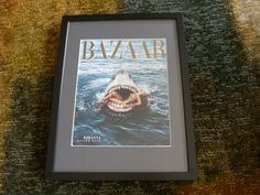 A magazine cover, matted and framed by Beatrice G
