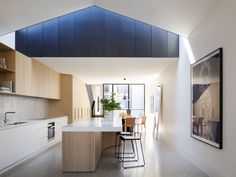 Pandolfini Architects melds steel, concrete, and oak in an elegant, double-height rear addition to a 100-year-old residence.