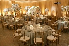 White centerpieces with warm peach accents, photos by John and Joseph Photography | junebugweddings.com