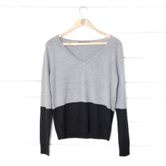 Grey and black color block v-neck sweater