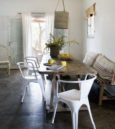 dream beach vacation home formentera easy interior dining -- me encanta la mesa rústica, sillas tolix, cojines de costal!